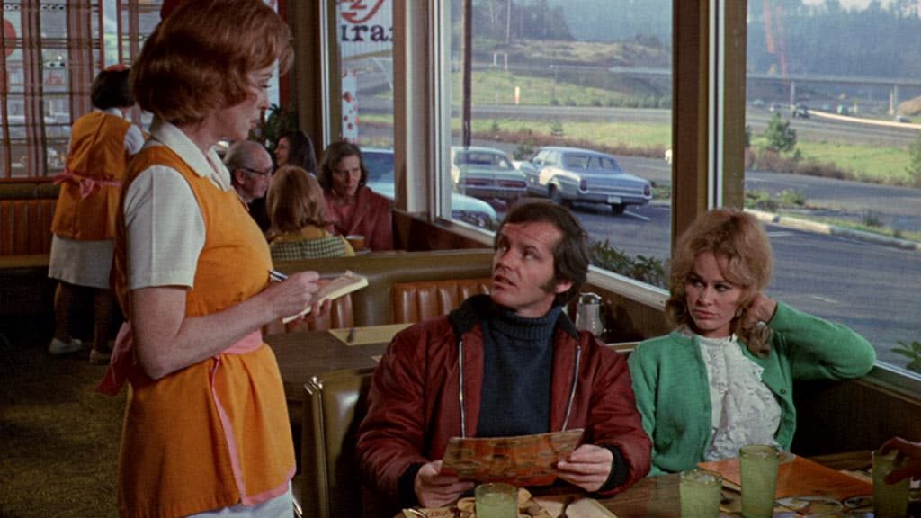 A waitress asks Jack Nicholson for his order in Five Easy Pieces